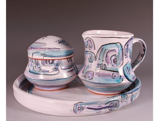 The Summer Potters Market will feature pieces such as this blue and violet sugar creamer set by Lafayette potter Angela Vinson.