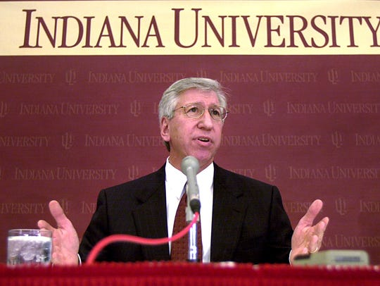 Former IU president Myles Brand announces the firing of basketball coach Bob Knight in September 2000.
