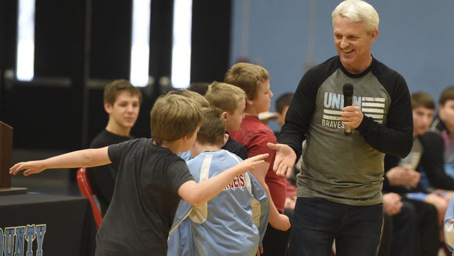 Union County coach Robert Ervin shakes hands with elementary school wrestlers during the pep rally after Union County won the state championship in 2016. Ervin was named the winner of the Garnis Martin Outstanding Coach Award on Thursday.