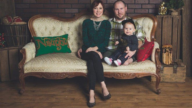 Aaron Causey, with his wife, Kat, and their daughter Alexandra, is among hundreds of post-9/11 troops who have suffered devastating wounds causing infertility or sexual dysfunction.