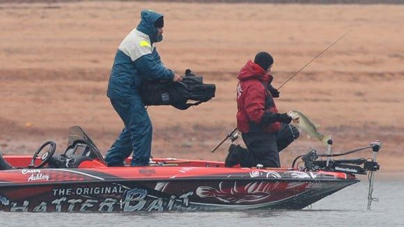 In this Feb. 22, 2008 photo, Casey Ashley catches his first fish during opening day of the 2008 Bassmaster Classic  on Lake Hartwell in Anderson. The tournament returns to Lake Hartwell in February.
