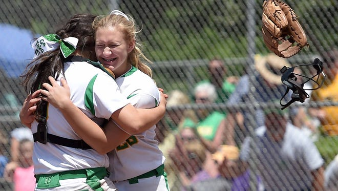 Taylorsville pitcher Lauren Stringer (right) hugs catcher Emily Vowell after the final out of Friday's 1-0 win against East Webster in the Class 2A championship series at Freedom Ridge Park in Ridgeland. Taylorsville swept the series and won its first state championship.