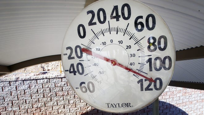 The thermometer at the Echo Canyon Trailhead on Camelback Mountain reads nearly 120 degrees on June 19, 2017, in Phoenix.