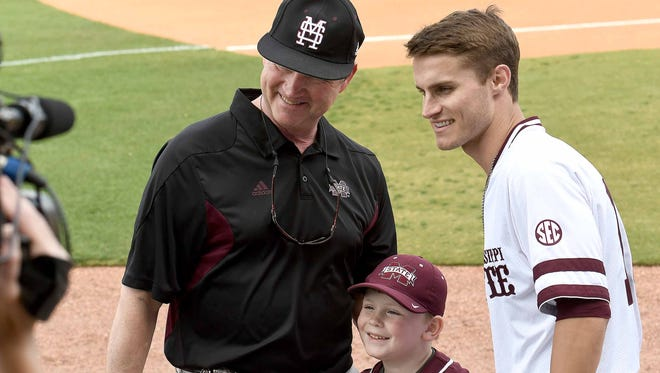Drew Morrow (center) of Brandon and his grandfather, David Morrow of Brandon, pose with Mississippi State's Jake Mangum on Tuesday, April 24, 2018, before the Governors Cup baseball game at Trustmark Park in Pearl, Miss.