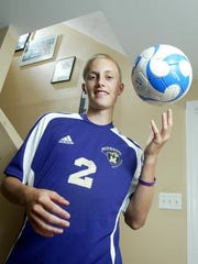 Ryan Miller at his home in Monroe in 2008 in front