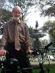 Historian Tom  Owen poses in front of the St. James Court fountain in 2001, when he was releasing a video about Old Louisville and the St. James area.