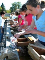 A class mines for gemstones at Apple Holler