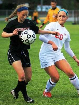 Canton's Chloe Donlin (right), shown from last season, is a senior co-captain who will fortify the midfield.