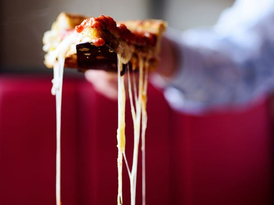 "Giordano's pizza touts its ""cheese pull."""