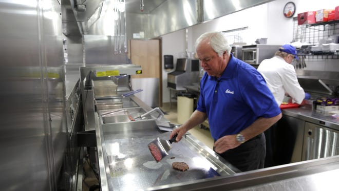 Craig Culver, Culver's co-founder, demonstrates how to make a Culver's ButterBurger at the company's headquarters in Prairie du Sac.