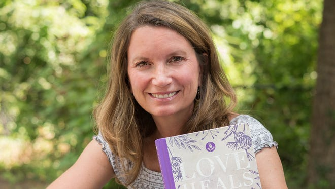 Rev. Becca Stevens, founder of Nashville women's healing center Thistle Farms, with her 2017 book Love Heals