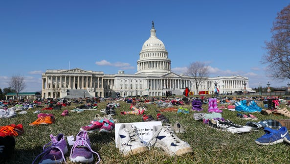 7000 pairs of shoes, one for every child killed by