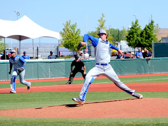 Carlsbad's Trevor Rogers throws a strike in the 6A