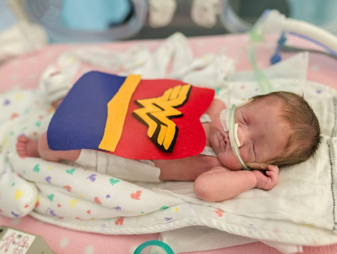 About 35 NICU babies received Halloween costumes at