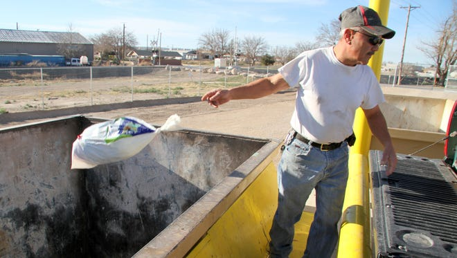 Ross Gonzales of Carlsbad dropped off his garbage at the new convenience center on Monday afternoon.