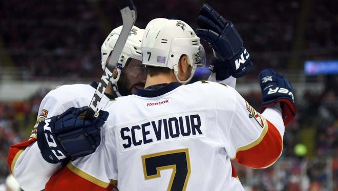 Panthers center Colton Sceviour (7) celebrates his second-period goal with defenseman Keith Yandle (3).