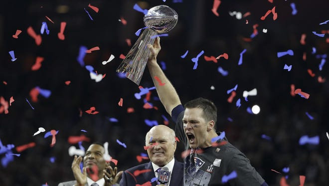 Tom Brady celebrates his fifth Super Bowl victory last week in Houston.