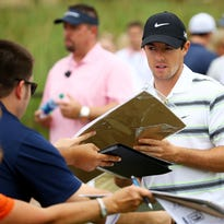Rory McIlroy signs autographs during a practice round for The Players Championship at the TPC Sawgrass Stadium course on May 6, 2015 in Ponte Vedra Beach, Florida.