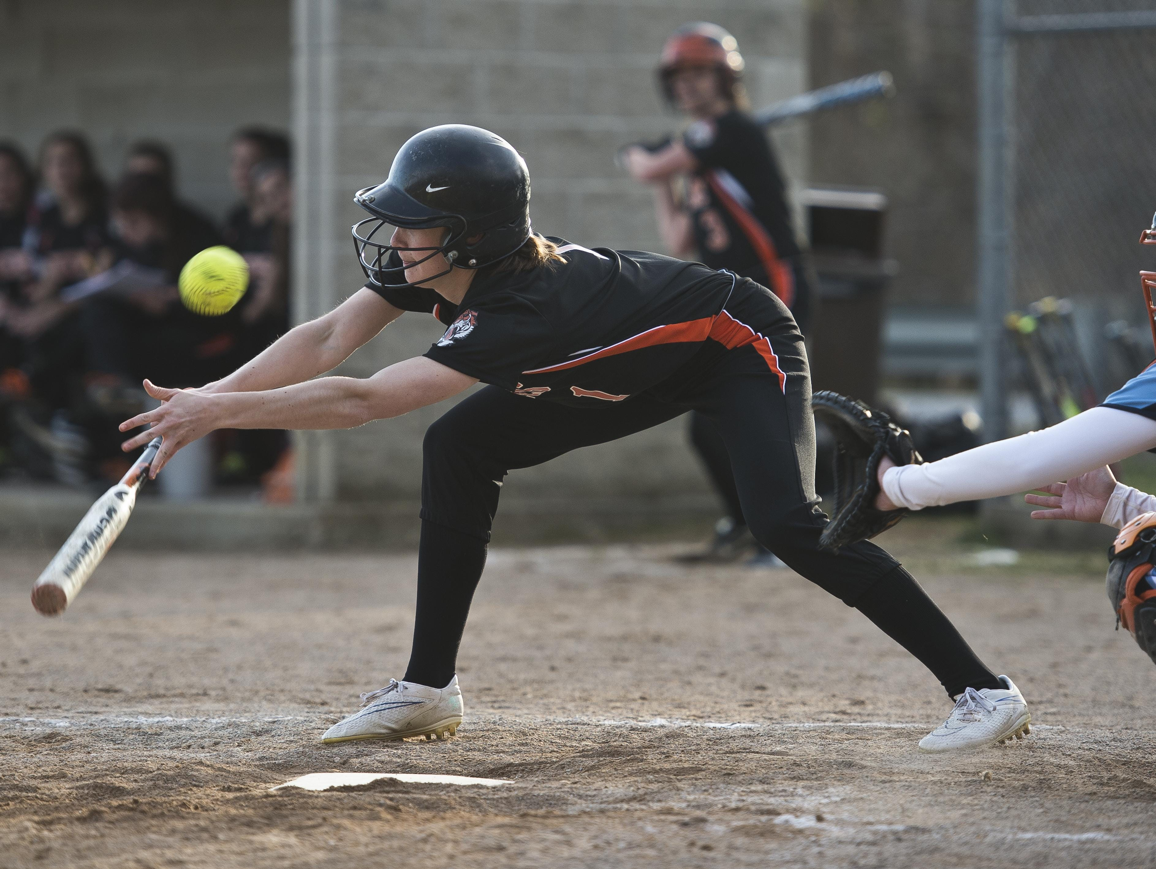 Middlebury's Lily Smith attempts to lay down a bunt during a game in April. Smith, the daughter of Vermont Shrine football coach Dennis Smith, has become a three-sport athlete since a surgery to correct scoliosis at a Shriners hospital.