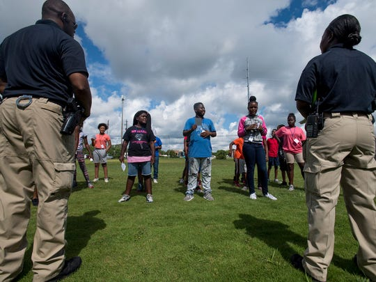 Sixth-grade students take part in the Montgomery Police Department's 17th annual Junior Police Academy as cadets on Wednesday July 12, 2017 in Montgomery, Ala.