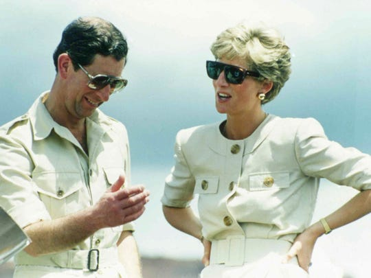 Prince Charles and Princess Diana laugh together in