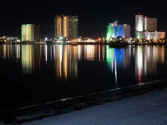 Lights from Pensacola Beach developments reflect in