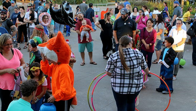 Hundreds of children play a variety of games at River Bend Nature Center's Not So Scary Halloween Friday evening.
