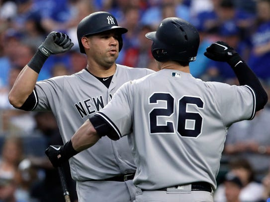 New York Yankees' Gary Sanchez, left, is congratulated