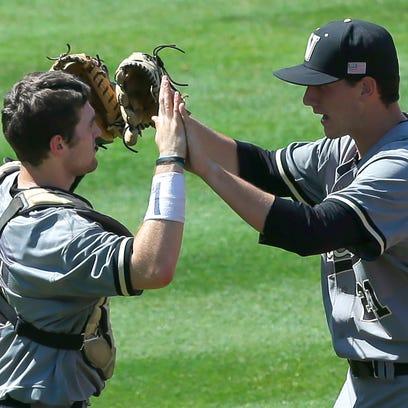 Vanderbilt's Jason Delay, left, and John Kilichowski