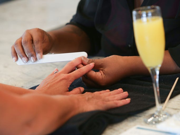 Wednesday July 23rd, 2014, Nail Technician, Jo Lawn Allen gives Indy Star Reporter Dana Benbow a manicure at the Beauty Bar at Geist,11691 Fall Creek Rd., which offers customers a full service salon, with cocktails.
