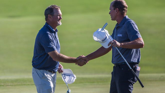 Jerry Kelly shakes hands with Steve Stricker at the end of their round during the Chubb Classic in Naples on Friday, February 16, 2018.