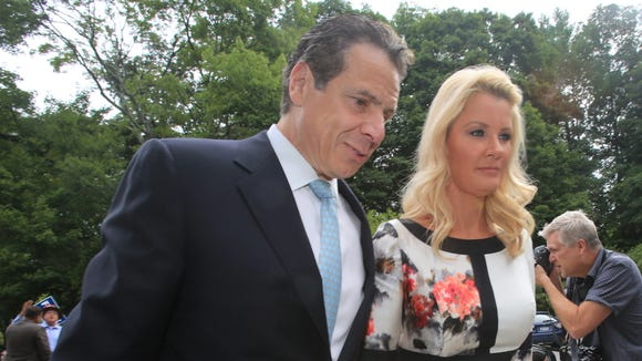 NY Gov. Andrew Cuomo and his girlfriend Sandra Lee arrive at Mt. Kisco Presbyterian Church in Mount Kisco to vote in the Democratic primary on Sept. 9, 2014
