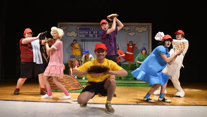 "Manav Jandu, center, is the title character in Sevastopol School's production of ""You're a Good Man, Charlie Brown."" Among the other cast members are, from left, Owen Ensign-Foulds as Linus, Lexie Henkel as Sally, Gavin Andersson as Schroeder, Lizzie Fiscus as Lucy, and Natalie Meikle as Snoopy."