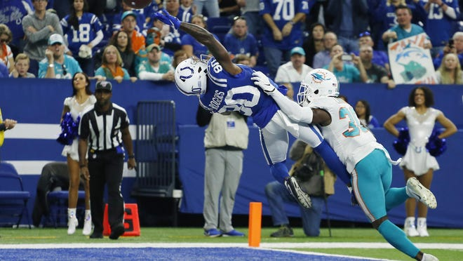 Indianapolis Colts receiver Chester Rogers (80) tries to make a game-winning catch against Dolphins cornerback Chris Lammons last season.