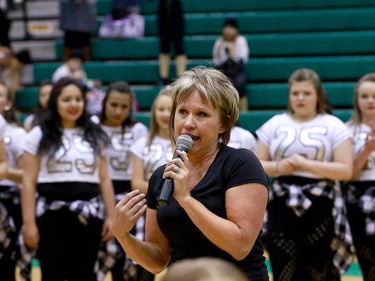 Sheila Mobley says goodbye to her students and their families on April 28 at The Force's annual showcase at Farmington High School.