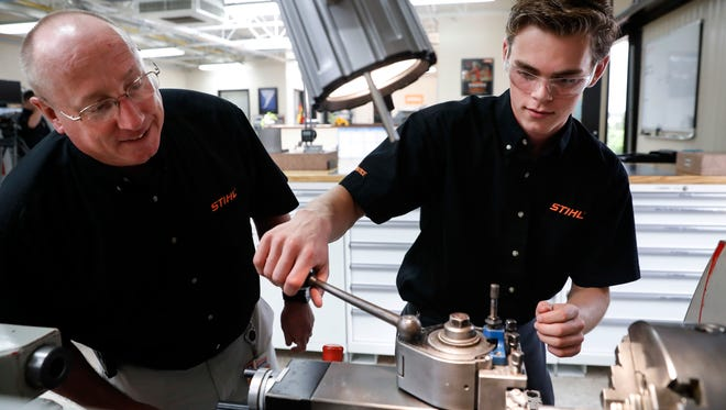 Apprentice Ryan Buzzy, right, works with Skip Johnson, a trainer for the Stihl Inc. apprenticeship program, on a metalworking lathe in their training area at the Stihl Inc. manufacturing facility in Virginia Beach, Va. On Friday, Sept. 1, 2017, the Institute for Supply Management, a trade group of purchasing managers, issues its index of manufacturing activity for August.