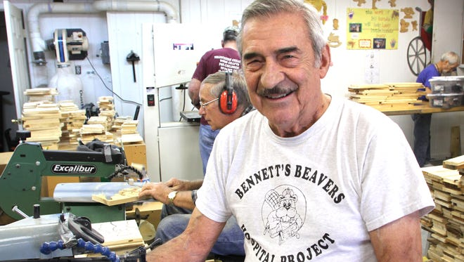 Hamburg Township volunteer Jim Bennett is founder of Bennett's Beavers, an all volunteer group which produces more than 50,000 wooden toys a year for distribution to children at hospitals across the country. When this photograph was taken in 2015, there were nearly 20 volunteers scurrying around the shop, hurrying to prepare for a holiday toy distribution.