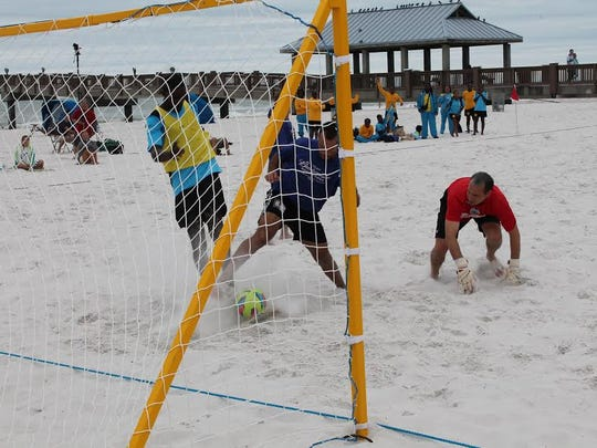 Major Beach Soccer action during 2016 Summer Qualifying Tournament Series in the adult over-30 division.
