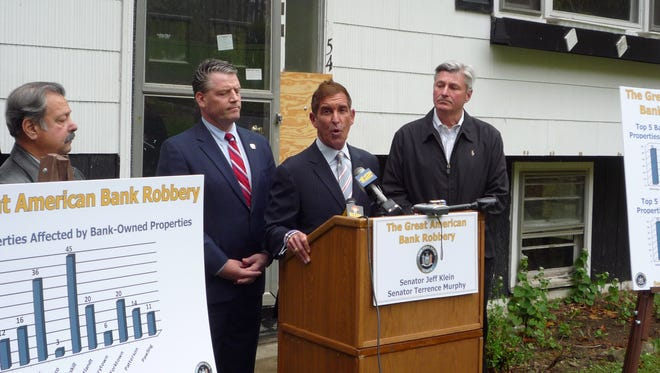 State Sen. Jeff Klein, center, along with Sen. Terrence Murphy (left) and Carmel town Supervisor Kenneth Schmitt (right), at a news conference announcing the report that detailed declining property values because of abandoned homes in the neighborhood.