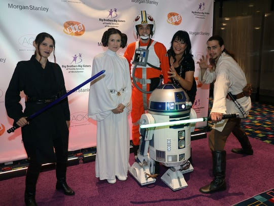 Star Wars characters pose for photos with guests at