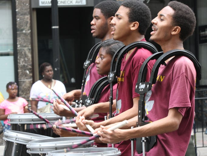 Members of Berean Community drumline in Brooklyn march in the 10th Annual Juneteenth Parade & Festival in downtown White Plains on June 14, 2014.