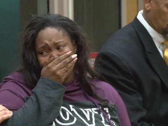 Kayla Wilson cries in court Wednesday as she is led