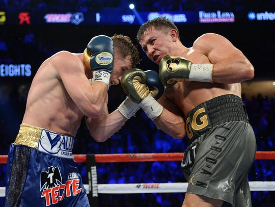 Gennady Golovkin, right, and Canelo Alvarez fought