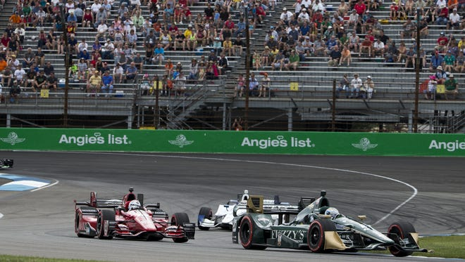 Cars go around the first two turns, Angie's List Grand Prix of Indianapolis, Saturday, May 9, 2015.