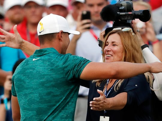 Brooks Koepka gets a hug from his mother, Denise Jakows, after Koepka won the PGA Championship golf tournament at Bellerive Country Club, Sunday, Aug. 12, 2018, in St. Louis. (AP Photo/Jeff Roberson) ORG XMIT: PGA249