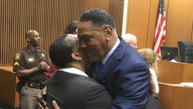 Richard Phillips, right, hugs Patricia Little in a Wayne County courtroom on March 28, 2018, in Detroit. Phillips, a Michigan man whose murder conviction was thrown out after he spent 45 years in prison will not face a second trial.