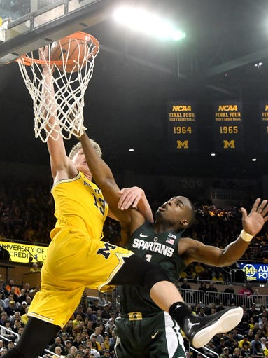 Michigan's Moritz Wagner draws a foul from Joshua Langford