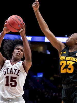 Mississippi State center Teaira McCowan, left, pulls in a rebound next to Arizona State guard Iris Mbulito during the first half of a regional semifinal in the NCAA women's college basketball tournament Friday, March 29, 2019, in Portland, Ore. (AP Photo/Craig Mitchelldyer)
