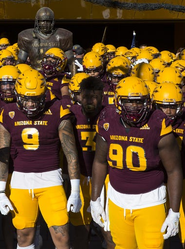 Arizona State head caoch Todd Graham leads his team onto the field against Arizona in the first half on Nov. 25, 2017 during the 91st Annual Territorial Cup in Tempe, Ariz.
