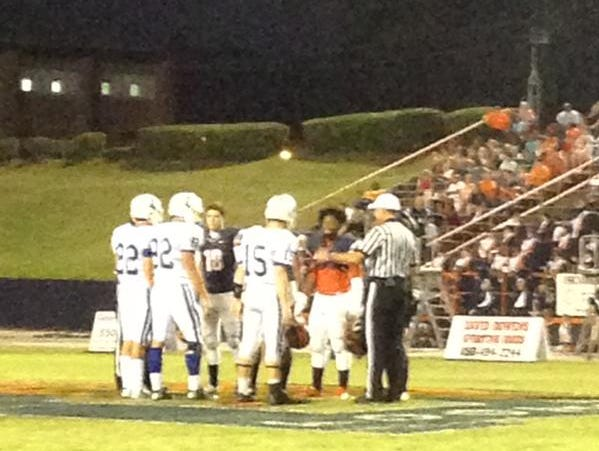 Captains call the coin toss for Jesuit at Escambia.
